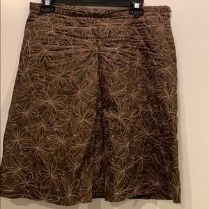 Brown skirt with embroidered flower detail
